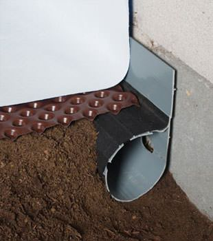 Closeup of a crawl space drainage system installed in Red Hook