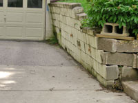 a failing retaining wall around a driveway in Poughkeepsie