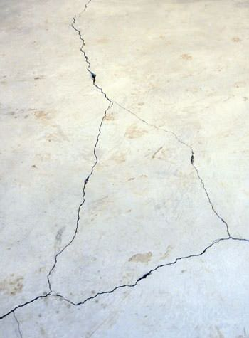 severely cracked, heaving slab floors in a home in Stony Point