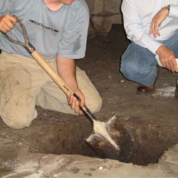 Digging a hole for the engineered fill used in a crawl space support system installation in Wappingers Falls