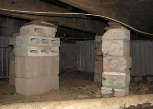 crawl space repairs done with concrete cinder blocks and wood shims in a New Paltz home
