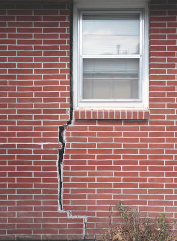 severe foundation wall cracks along a window in Highland