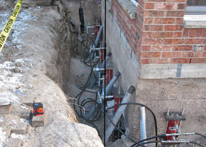 Foundation push piers installed around a house with a foundation settlement issues in Red Hook