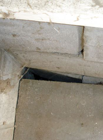 inward rotation of a foundation wall damaged by street creep in a garage in Highland