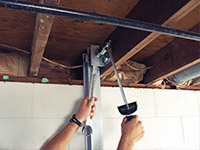 Straightening a foundation wall with the PowerBrace™ i-beam system in a Nanuet home.