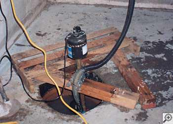 A Beacon sump pump system that failed and lead to a basement flood.
