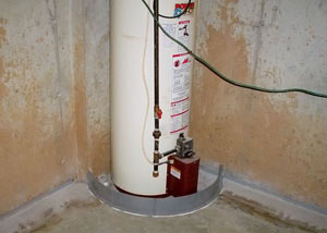 A water heater in Warwick that's been protected by the FloodRing® and a perimeter drain system.
