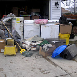 Soaked, wet personal items sitting in a driveway, including a washer and dryer in Wappingers Falls.