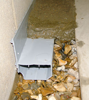 A basement drain system installed in a Wappingers Falls home