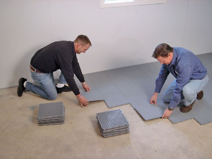 ... Contractors installing basement subfloor tiles and matting on a concrete basement floor in Kingston New : floor options for basement  - Aeropaca.Org